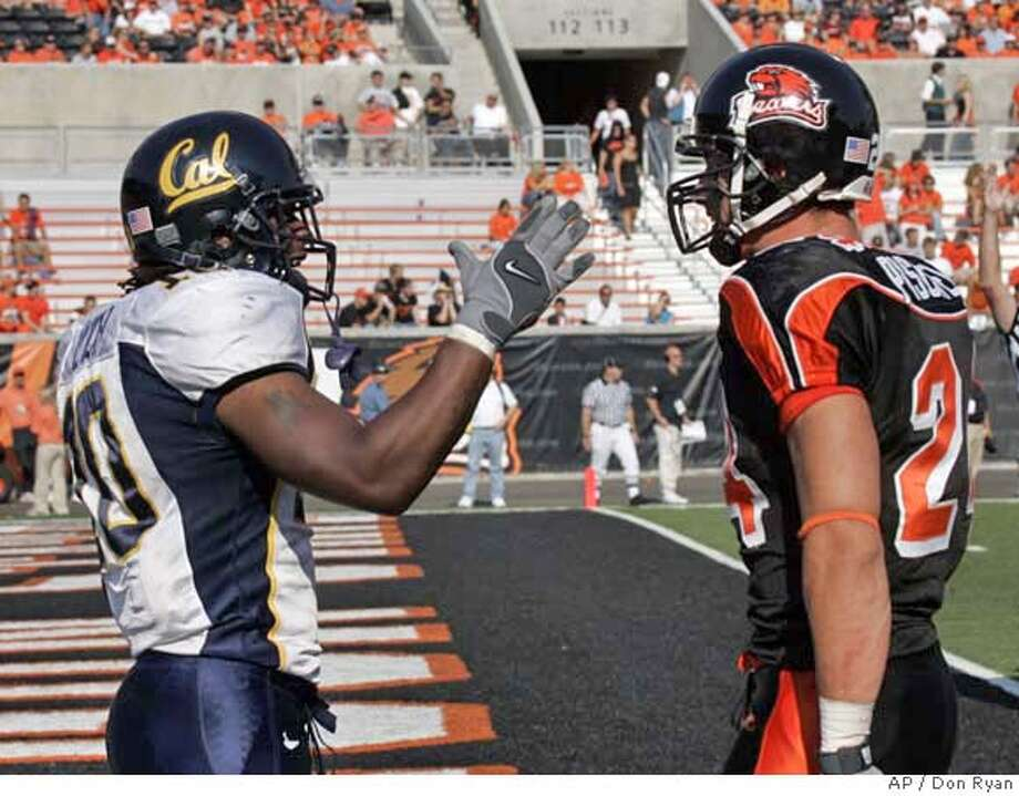 California running back Marshawn Lynch, left, gestures in the face of Oregon State defender Sabby Piscitelli after scoring a third-quarter touchdown against him during college football action in Corvallis, Ore., Saturday, Sept. 30, 2006. Lynch ran for 106 yards, caught passes for 59 yards and scored 3 touchdowns as California beat Oregon State, 41-13.(AP Photo/Don Ryan) Photo: DON RYAN