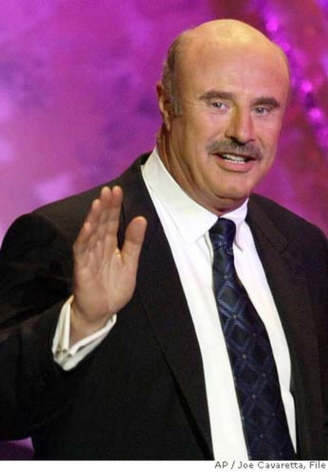 "** FILE ** Dr. Phil McGraw is seen at the Academy of Country Music Awards at the Mandalay Bay Resort & Casino in Las Vegas, in this 26, 2004 file photo. Unhappy customers who sued ""Dr. Phil"" McGraw over his now discontinued Shape Up! diet plan have reached a $10.5 million settlement agreement with the TV psychologist, an attorney for the plaintiffs said. (AP Photo/Joe Cavaretta, File) A MAY 26 2004 FILE PHOTO Photo: JOE CAVARETTA"