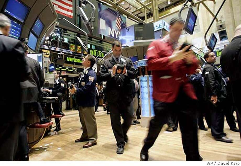 Traders and Specialists work the trading floor at the New York Stock Exchange on the last trading day in September Friday, Sept. 29, 2006 (AP Photo/David Karp) Photo: DAVID KARP
