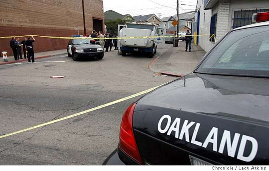 Oakland police investigate the shooting death of a Brinks security officer at 23rd Avenue and East 10th St. in Oakland, Calif. on Friday, Sept. 29, 2006  LACY ATKINS/The Chronicle Photo: LACY ATKINS