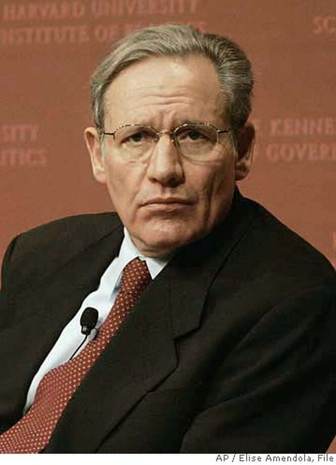 **FILE** Bob Woodward appears before speaking with Carl Bernstein in this Monday Dec. 5, 2005 file photo, at the John F. Kennedy School of Government at Harvard University in Cambridge, Mass. Former White House chief of staff Andrew Card twice sought to persuade President Bush to fire Defense Secretary Donald Rumsfeld, the second time with the support of first lady Laura Bush, Woodward writes in a new book on the Bush administration's Iraq war policy. (AP Photo/Elise Amendola, File) DEC 5, 2005 FILE PHOTO PHOTO Photo: ELISE AMENDOLA