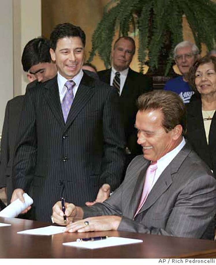 Gov. Arnold Schwarzenegger, right, laughs at a comment by Assembly Speaker Fabian Nunez while signing Nunez' measure creating a prescription drug discount program during a ceremony held at the Capitol in Sacramento, Calif., Friday, Sept. 29, 2006. (AP Photo/Rich Pedroncelli) Photo: RICH PEDRONCELLI