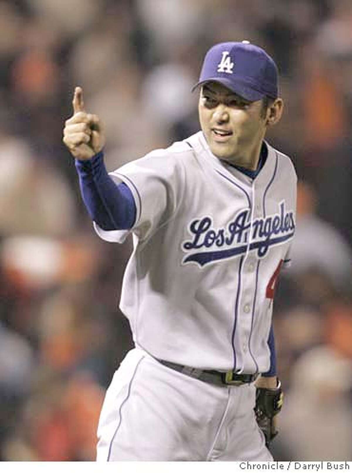 giants_0008_db.JPG Los Angeles Dodgers pitcher Takashi Saito celebrates after stopping the Giants in the 9th for the victory San Francisco Giants vs. Los Angeles Dodgers at AT&T Park in San Francisco, CA on Friday, September 29, 2006. 9/29/06 Darryl Bush / The Chronicle ** (cq) Ran on: 09-30-2006 Takashi Saito knows the Dodgers magic number for clinching a playoff spot after saving Fridays game with the Giants.