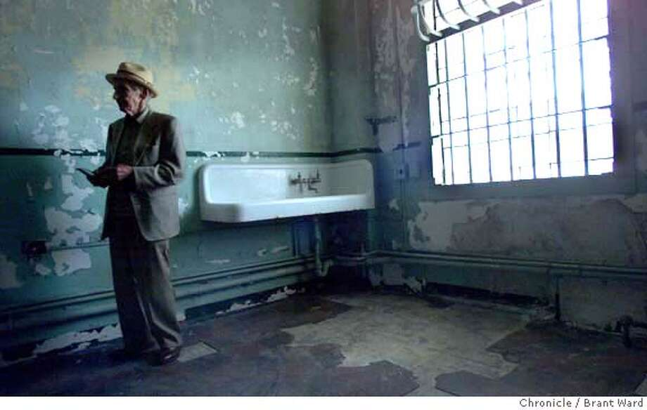 """William Radkay tours his old prison, Alcatraz, Sunday, Aug. 13, 2000, where he spent seven years. He fondly remembered his stay where his cell was right next to Machine gun Kelly's. Radkay, now 89, said he still has five slugs in him for not stopping one day when the police yelled """"Halt!"""" He said he keeps them """"for posterity."""" He hung around with Machine Gun Kelly and Pretty Boy Floyd and was fast friends with Baby Face Nelson's driver. (AP Photo/San Francisco Chronicle, Brant Ward) CAT Photo: BRANT WARD"""