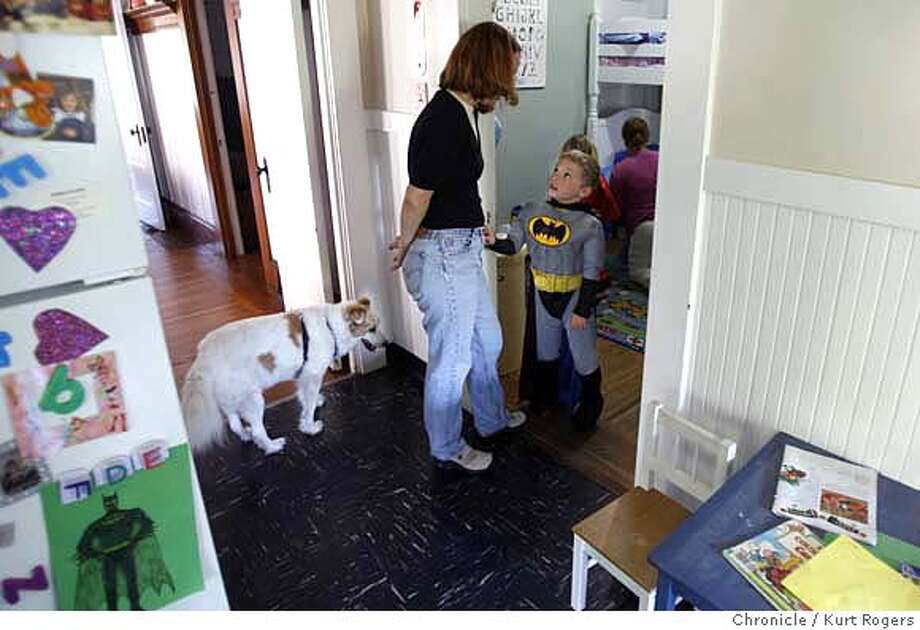 """Philippa Barron's and her son Jackson Pilisuk 5 years old in his Batman outfit and Shelby their dog.  This is a story about the trend of parents holding back -- or """"redshirting"""" -- their kindergarteners. The situation is exacerbated in California, which has one of the latest cut-off dates for school entrance in the country, Dec. 2. A bill is pending in the legislature to move the date up to Sept. 1.  KURT ROGERS /THE CHRONICLE SAN FRANCISCO THE CHRONICLE  SFC KINDERGARTENXX_0123_kr.jpg MANDATORY CREDIT FOR PHOTOG AND SF CHRONICLE / -MAGS OUT Photo: KURT ROGERS /THE CHRONICLE"""
