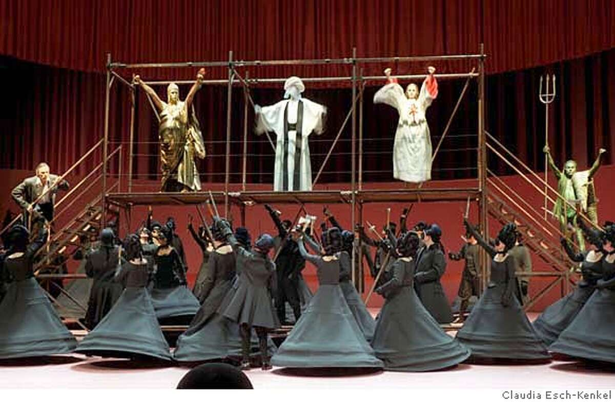 (FILE) - (L-R) Buddha, Mohamed, Poseidon and Jesus as the 'Spiritual leaders' stand on a podium during the dress rehearsal of the oper 'Idomeneo' byWolfgang Amadeus Mozart at the Deutsche Oper Berlin, Germany, 11 March 2003. The Deutsche Oper Berlin cancelled the current staging of the opera on Monday, 25 September due to fear of possible Islamic hostilities. The staging deals critically with the world's religions, among them the Islam. Photo: Claudia Esch-Kenkel