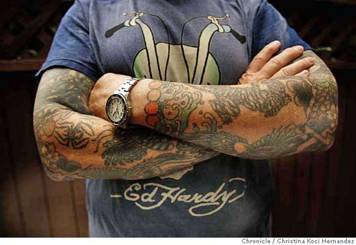 Detail of Hardy's arms.Don Ed Hardy, in his North each studio, in SF, is a renowned tattoo and fine artist whose images are now being branded on T-shirts, jackets and other merchandise that will gross $20 million this year. He's a fascinatinh guy who studied and works in japan, knows about all kinds of art and crosses a lot of boundaries. (CHRISTINA KOCI HERNANDEZ/THE CHRONICLE) Mandatory Credit For Photographer and San Francisco Chronicle/No-Sales-Mags Out