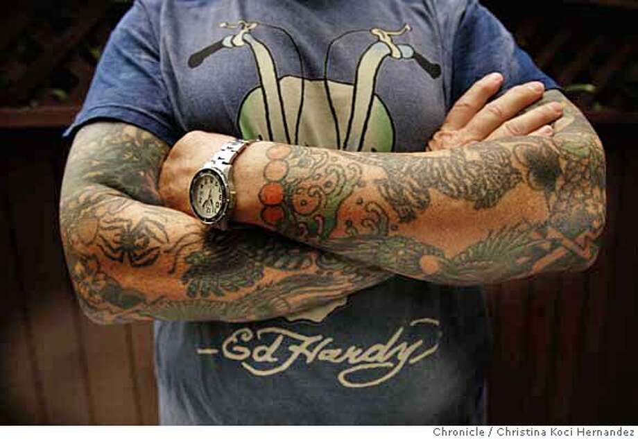 Detail of Hardy's arms.Don Ed Hardy, in his North each studio, in SF, is a renowned tattoo and fine artist whose images are now being branded on T-shirts, jackets and other merchandise that will gross $20 million this year. He's a fascinatinh guy who studied and works in japan, knows about all kinds of art and crosses a lot of boundaries. (CHRISTINA KOCI HERNANDEZ/THE CHRONICLE) Mandatory Credit For Photographer and San Francisco Chronicle/No-Sales-Mags Out Photo: Christina Koci Hernandez