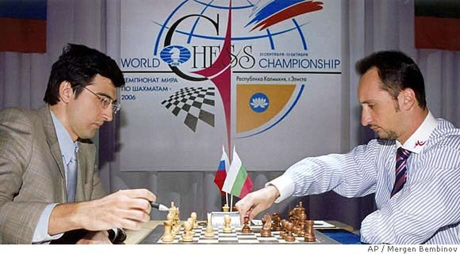 World Chess Champion Veselin Topalov, right, and Classical World Champion Vladimir Kramnik, left, play the first of a three-week series of matches in Elista, capital of Russia's majority Buddhist region of Kalmykia on Saturday, Sept. 23, 2006, picture. The three-week series of matches intended to end the schism that has riven the chess world for 13 years. The two 31-year-old players are to share the US$1 million prize no matter who wins the title. (AP Photo/Mergen Bembinov) Photo: MERGEN BEMBINOV