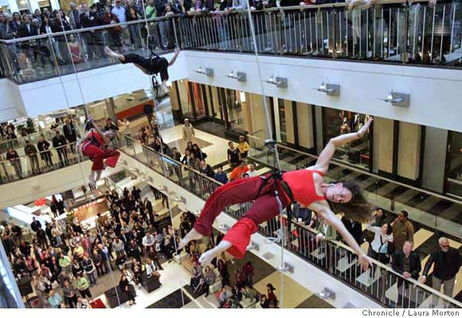 Amelia Rudolph (right), artistic director of Project Bandaloop, performs during the opening ceremonies of the Westfield San Francisco Centre expansion on Thursday morning. MANDATORY CREDIT FOR PHOTOGRAPHER AND SAN FRANCISCO CHRONICLE/ -MAGS OUT Photo: Laura Morton
