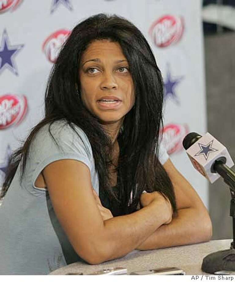 Kim Etheredge, publicist for Dallas Cowboys wide receiver Terrell Owens, responds to a question during a press conference at the Cowboys training facility in Irving, Texas, Wednesday, Sept. 27, 2006.(AP Photo/Tim Sharp) Photo: TIM SHARP