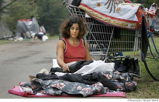 homeless160.jpg  Heiyam Bajjalieh-Malloy rested near Stanyan street on the east side of Golden Gate Park. She usually sleeps on the sidewalk nearby, but then ventures back into the park during the day.  City officials have been directed to find services and rid San Francisco's Golden Gate Park of its' homeless population.  A flyer, handed out to those sleeping in the park, set a deadline of Thursday September 28 to leave.  Although the homeless are aware of the warning, there was not a mass exodus during the day. Neither was there much of a police or homeless outreach presence during the day Thursday.{Brant Ward/The Chronicle} 9/28/06 MANDATORY CREDIT FOR PHOTOGRAPHER AND SAN FRANCISCO CHRONICLE/ -MAGS OUT Photo: Brant Ward