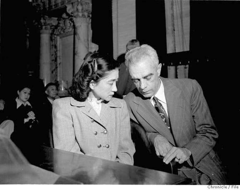 """TOKYO ROSE/07OCT49/MN/CHRON - Iva Toguri d'Aguino, known two American service men as """"Tokyo Rose"""", was the only person tried as """"Tokyo Rose"""". Her attorney Wayne Collins is with her in San Francisco courtroom. Photo by Chronicle Photo: CHRONICLE"""