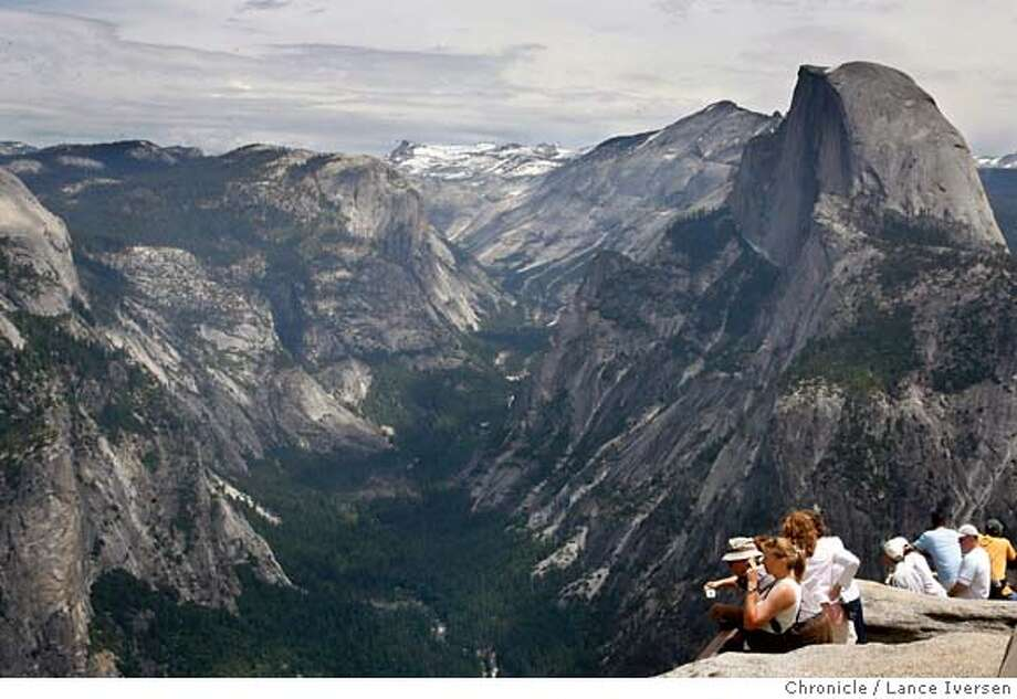 YOSEMITE322.JPG  SIERRAWARMING. Tourists can take in nature�s splendor atop Glacier Point overlooking Half Dome and the valley floor. 6/7/06 in YOSEMITE.By Lance Iversen/San Francisco Chronicle MANDATORY CREDIT PHOTOG AND SAN FRANCISCO CHRONICLE/ MAGS OUT Photo: By Lance Iversen