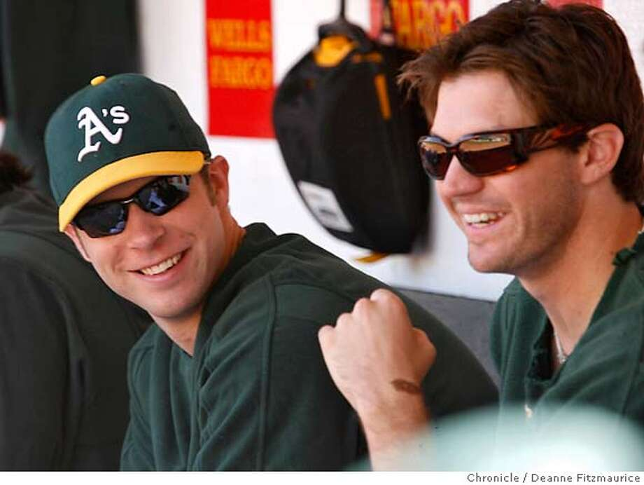 athletics_103_df.JPG  Rich Harden is back in the line up as the starting pitcher and gets the win. He shares a laugh with Barry Zito at right. Athletics win over Cleveland Indians at McAfee Coliseum in Oakland on 9/21/06.  (Deanne Fitzmaurice/ The Chronicle) Mandatory credit for photographer and San Francisco Chronicle. /Magazines out. Photo: Deanne Fitzmaurice