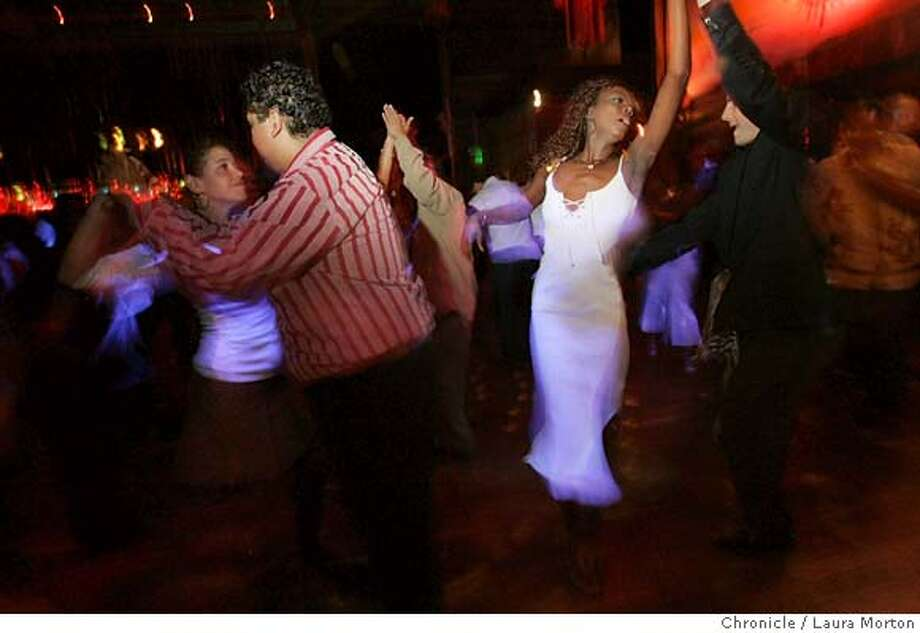 Sonia Bell (right) salsa dances on a Saturday night at Cafe Cocomo in San Francisco, CA. MANDATORY CREDIT FOR PHOTOGRAPHER AND SAN FRANCISCO CHRONICLE/ -MAGS OUT Photo: Laura Morton