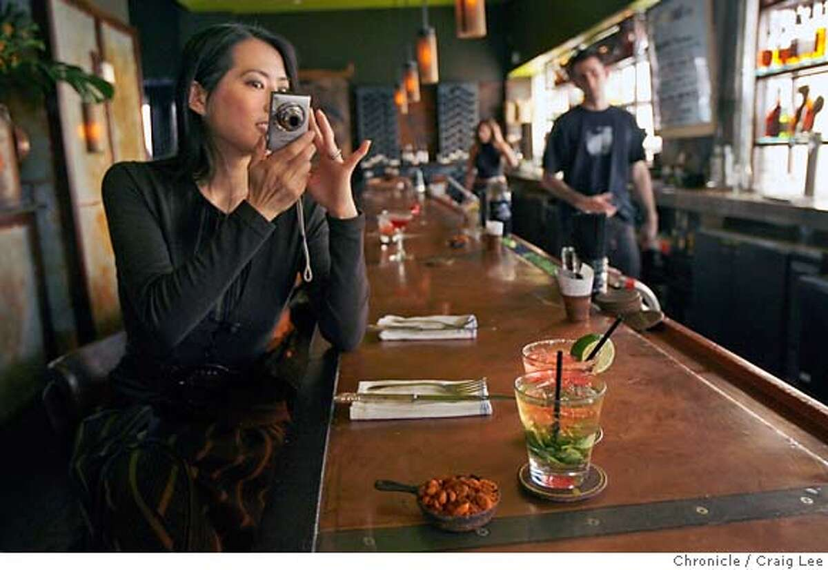 FOODPHONE30_015_cl.JPG Photo of Edie Ichioka taking photos of food the eat at restaurants for her food blog at www.bunrab.com. This was at Farmer Brown restaurant at 25 Mason in San Francisco. Craig Lee / The Chronicle MANDATORY CREDIT FOR PHOTOG AND SF CHRONICLE/ -MAGS OUT