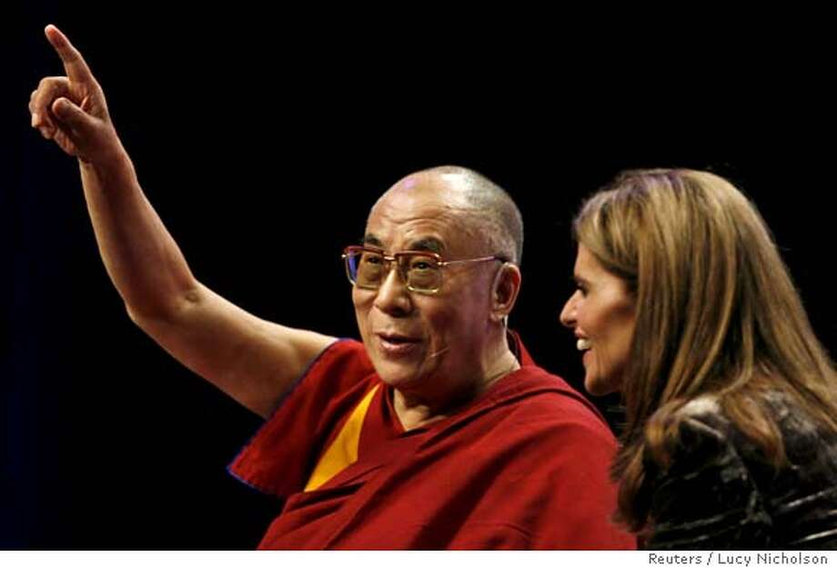 The Dalai Lama (L) addresses the audience as he sits with California First Lady Maria Shriver at the 2006 California Governor & First Lady's Conference on Women in Long Beach, California, September 26, 2006. REUTERS/Lucy Nicholson (UNITED STATES) 0 Photo: LUCY NICHOLSON
