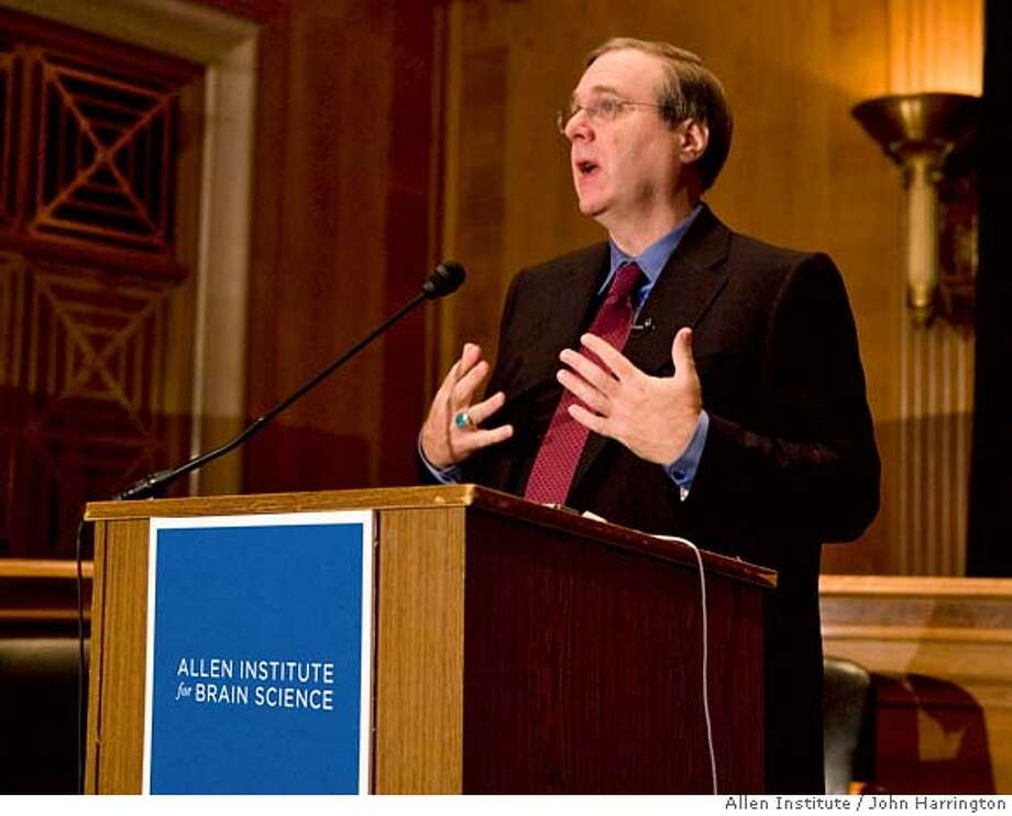 In this photograph provided by the Allen Institute, philanthropist and investor Paul G. Allen announces the completion of the revolutionary Allen Brain Atlas research project by the Allen Institute for Brain Science, Tuesday, Sept. 26, 2006, on Capitol Hill in Washington. Allen founded the institute three years ago, mapping how and where genes are expressed throughout the brain, a tool that may revolutionize the treatment and prevention of brain afflictions such as Alzheimer's, autism, epilepsy, Parkinson's, addiction and depression. (AP Photo/Allen Institute, John Harrington) PHOTO RELEASED BY THE ALLEN INSTITUTE NO ARCHIVE Photo: JOHN HARRINGTON
