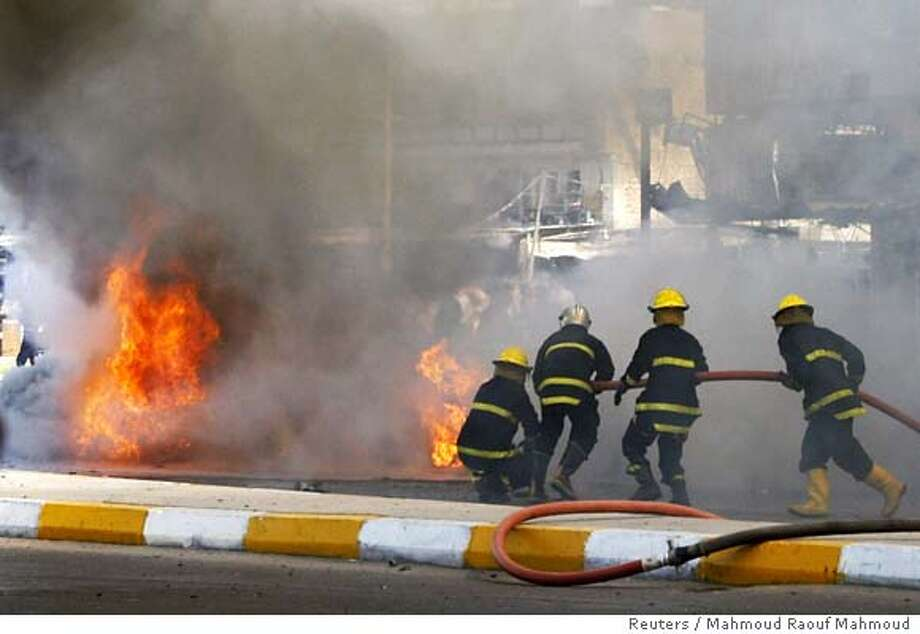 Firemen rush to the scene of a suicide motorcycle bomb attack in Baghdad September 26, 2006. The suicide attack targeting a police checkpoint killed four people and wounded 18 others, police said. REUTERS/Mahmoud Raouf Mahmoud (IRAQ) 0 Photo: MAHMOUD RAOUF MAHMOUD