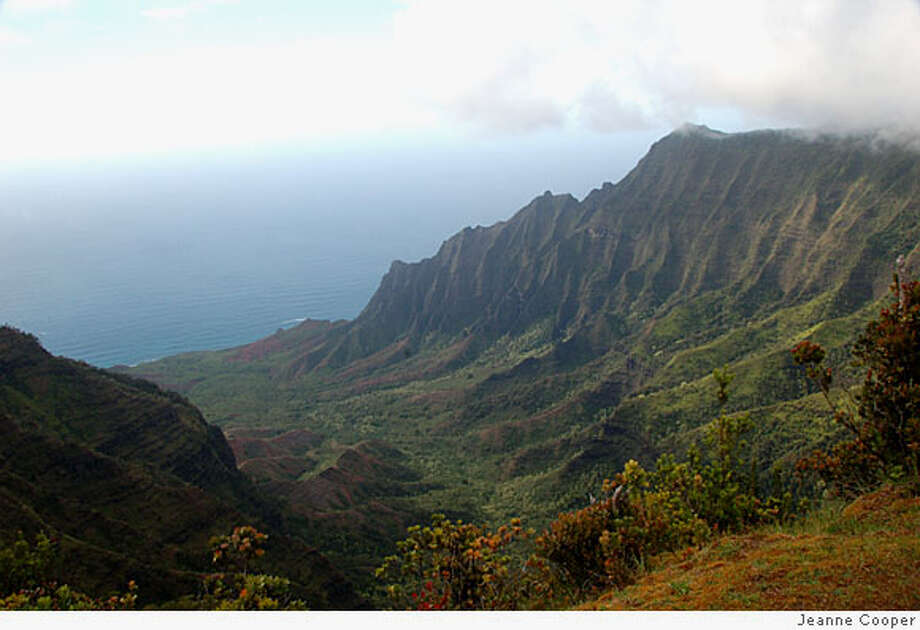 Rather not hike, paddle, float or fly? You can still drive to the Kalalau overlook for sweeping views of Na Pali's razorback cliffs. Photo by Jeanne Cooper