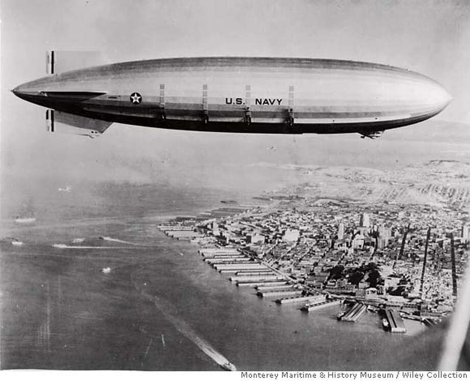 Flying over the city of San Francisco the USS  Macon was a familiar sight across the United States. Thousands of people would turn out to  observe the �flying aircraft carrier� conducting training maneuvers. The USS Macon was  constructed with a built-in aircraft hanger and a trapeze launch and recovery system to facilitate  fighter planes intended to protect the aircraft in war. credit: Courtesy of Wiley Collection, Monterey Maritime & History Museum Photo: V