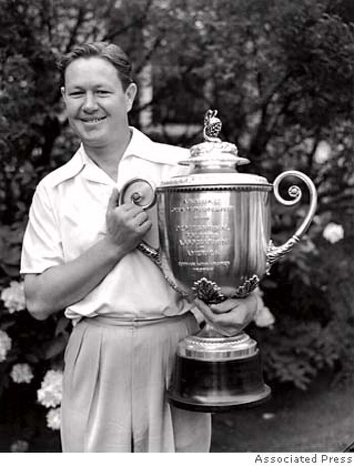 ** FILE ** Byron Nelson is holding his trophy after winning the PGA championship in Hershey, PA., on Sept. 2, 1939. Nelson, who had the greatest year in the history of professional golf when he won 18 tournaments in 1945, including a record 11 in a row, died Tuesday Sept. 26, 2006. He was 94.(AP Photo) Photo: Afdd