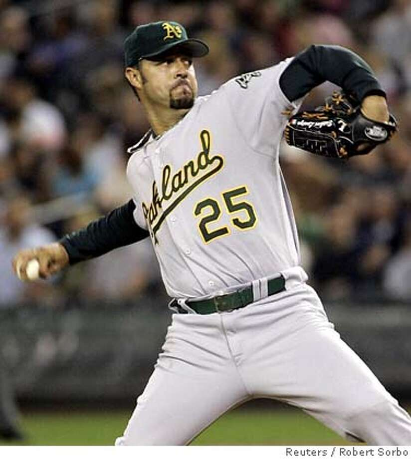 Oakland Athletics pitcher Esteban Loaiza delivers a pitch against the Seattle Mariners during the second inning of their American League baseball game in Seattle, Washington, September 25, 2006. REUTERS/Robert Sorbo (UNITED STATES)  Ran on: 09-26-2006  Oakland's Esteban Loaiza fires toward home plate in Seattle as the A's tried to clinch the Al West crown Monday night. That game, and the Giants' game with Arizona, ended too late for this edition. To read the game stories, go to SFGate.com-sports.  Ran on: 09-26-2006 Photo: ROBERT SORBO
