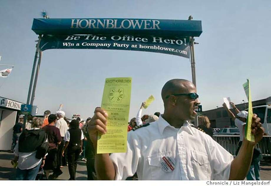 Dushan Crawford, an employee with Blue and Gold Ferry Service, hands out leaflets in front of the Hornblower dock. Protesters were out in front of Hornblower Cruises, which has the new contract the ferry service to Alcatraz. Photographed in SF on Sept. 25th, 2006.  Liz Mangelsdorf /The Chronicle ***Dushan Crawford (cq) MANDATORY CREDIT FOR PHOTOG AND SF CHRONICLE/ -MAGS OUT Photo: Liz Mangelsdorf