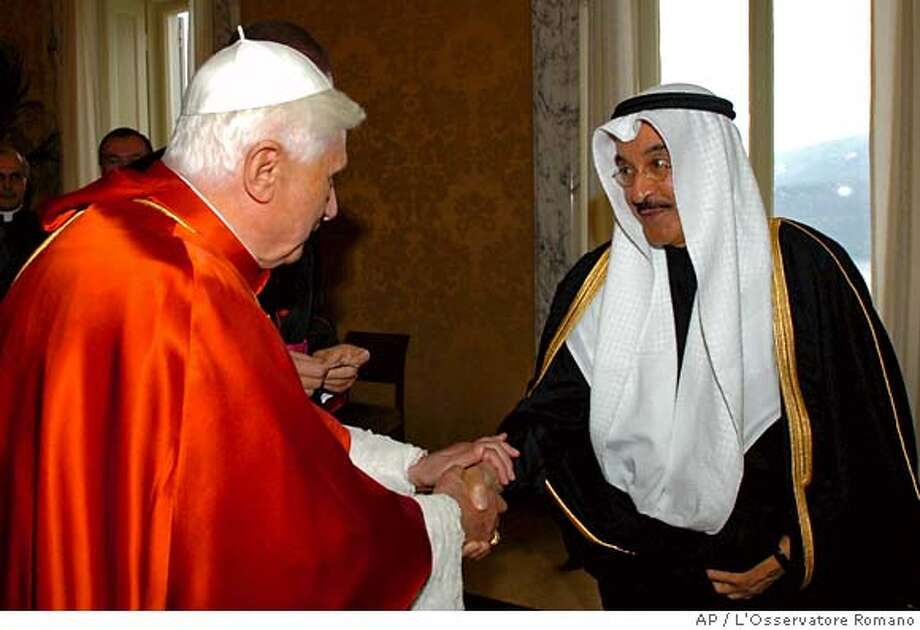 "In this photo provided by the Vatican newspaper L'Osservatore Romano, Pope Benedict XVI shakes hands with the Kuwait ambassador to the Holy See Ahamad Abdulkareem Al-Ibrahim prior to a meeting with Muslim diplomats and members of the Arab League, at Castel Gandolfo, Pope Benedict XVI's summer residence outside Rome, Monday, Sept. 25, 2006. Pope Benedict XVI told Muslim diplomats Monday that ""our future'' depends on good relations between Christians and Muslims as he sought to put to rest anger over his recent remarks about Islam and violence. (AP Photo/L'Osservatore Romano, ho) PHOTO PROVIDED BY VATICAN NEWSPAPER L'OSSERVATORE ROMANO Photo: L'Osservatore Romano, Ho"