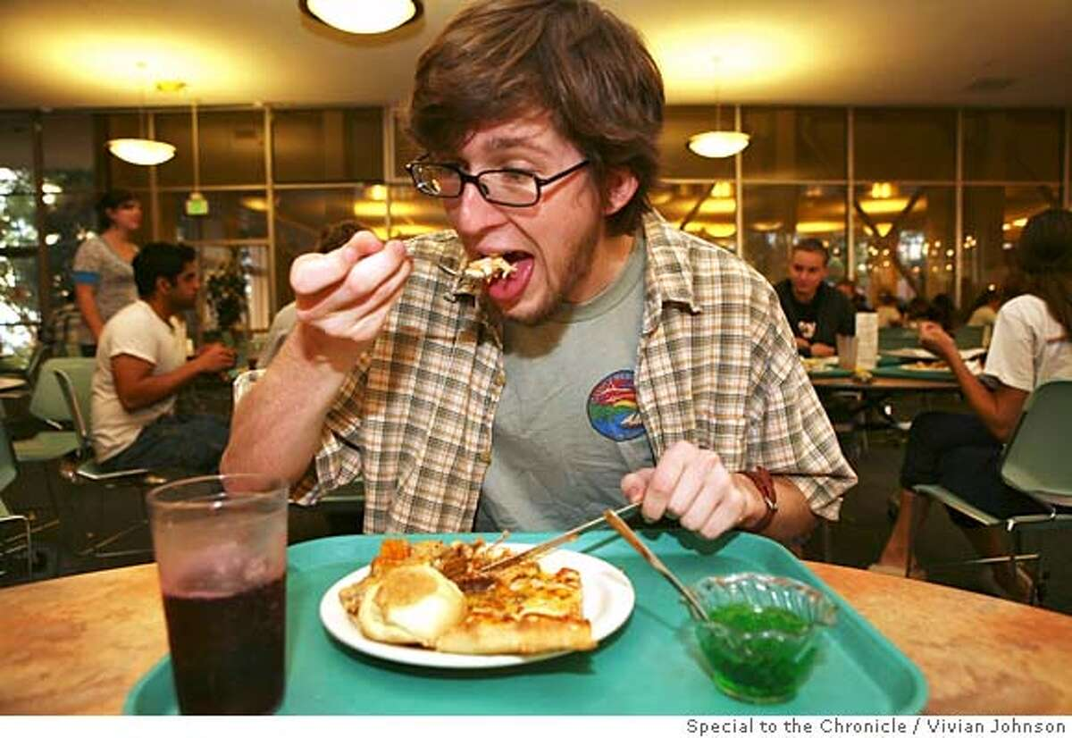FRESHMAN15- Mike Moore (CQ), an 18-year-old Freshman at SFSU, has dinner at the City Eat's Cafe which is an all-you-can-eat dining hall on campus . Vivian Johnson /