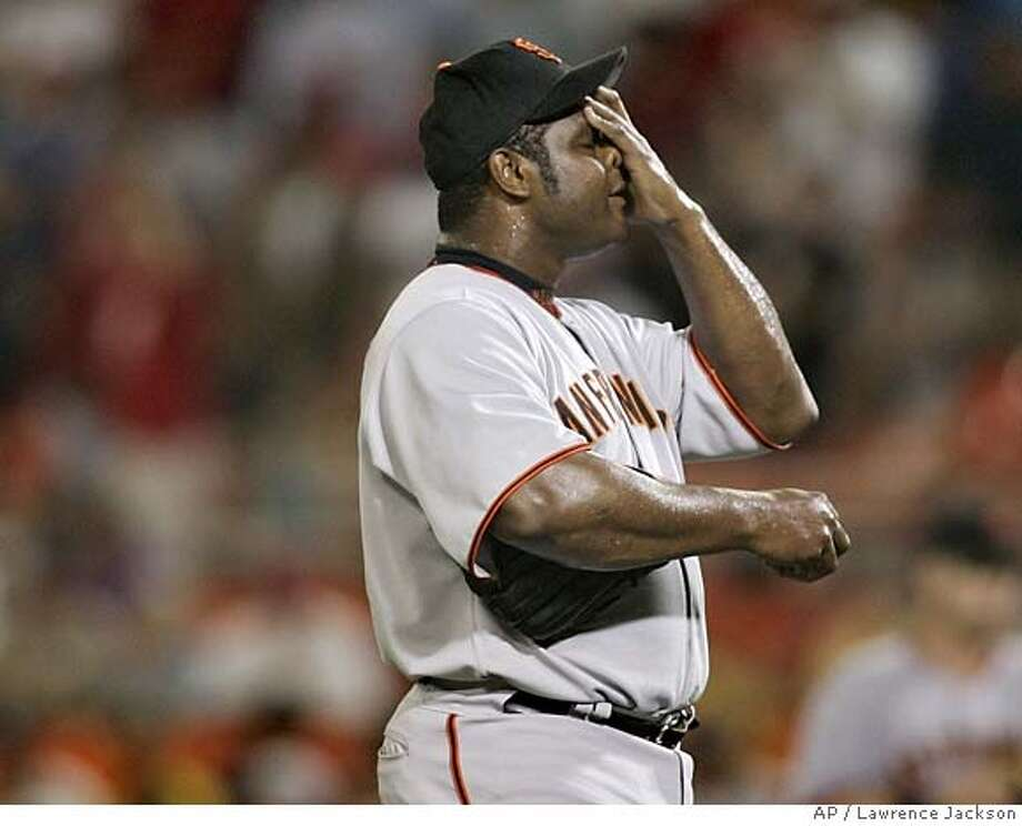 San Francisco Giants closer Armando Benitez wipes his brow in the ninth inning of a baseball game against the Washington Nationals, Wednesday, July 26, 2006, in Washington. Benitez gave up two hits and two runs in the ninth inning giving the Nationals the 4-3 win. It was Benitez's sixth blown save this season, in 19 chances.(AP Photo/Lawrence Jackson)  Ran on: 07-27-2006  Ray Durham has a grounder clank off his glove in the ninth inning. It was ruled a hit.  Ran on: 07-27-2006  Ray Durham has a grounder clank off his glove in the ninth inning. It was ruled a hit. EFE OUT Photo: LAWRENCE JACKSON