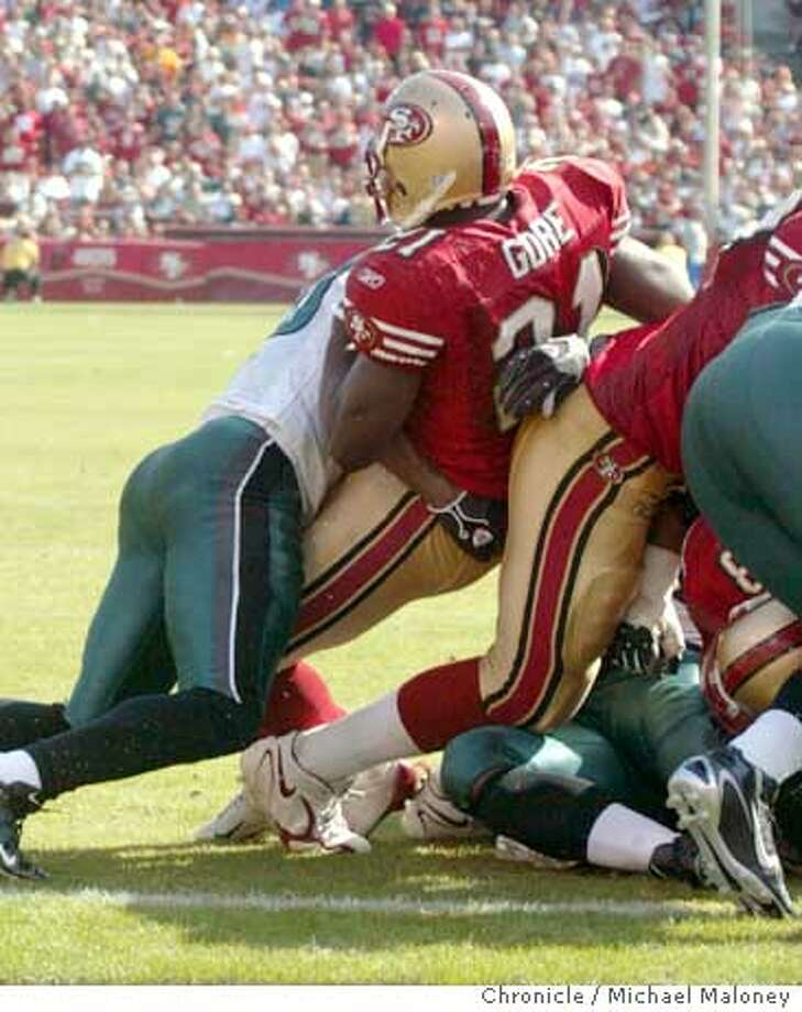 49ers Frank Gore (#21) fumbles at the 1 yard line. The ball was returned for a eagles TD in the 3rd quarter. The San Francisco niners play the Philadelphia Eagles at Monster Park in San Francisco on Sept. 24th, 2006.  Michael Maloney /The Chronicle Ran on: 09-25-2006  Frank Gore lost a fumble for the third game in a row, and the ramifications of the play could stay with the 49ers for quite some time.  Ran on: 09-25-2006  Frank Gore lost a fumble for the third game in a row, and the ramifications of the play could stay with the 49ers for quite some time. Photo: Michael Maloney