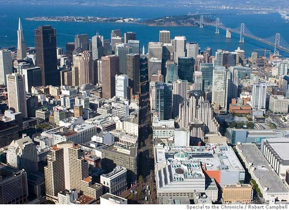Aerial photo made Friday, August 25, 2006. View of downtown San Francisco looking toward the east. Westfield San Francisco Centre including new Bloomingdale's appears in lower center of the frame. Market Street bisects the frame, with the Ferry Building tower at the center. CREDIT: Robert Campbell/Special to The Chronicle Photo: Robert Campbell