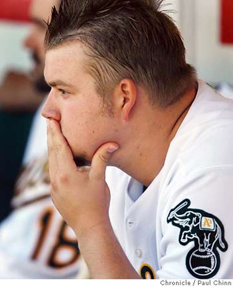 Starter Joe Blanton (16-12) ponders his 12th loss of the season. The Oakland Athletics vs. Los Angeles Angels game at McAfee Coliseum in Oakland, Calif. on Saturday, Sept. 23, 2006. The Angels beat the A's, 6-2.  PAUL CHINN/The Chronicle  **Joe Blanton MANDATORY CREDIT FOR PHOTOGRAPHER AND S.F. CHRONICLE/ - MAGS OUT Photo: PAUL CHINN