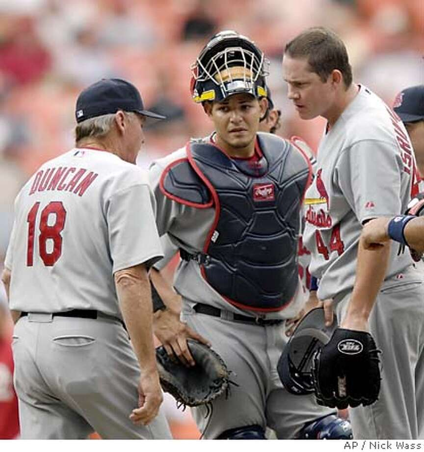St. Louis Cardinals closer Jason Isringhausen (44) talks to pitching coach Dave Duncan (18) during a conference on the mound in a baseball game against the Washington Nationals during the ninth inning, Wednesday, Sept. 6, 2006 in Washington. Also pictured is catcher Yadier Molina, center. Isringhausen was saddled with the loss as the Nationals won 7-6. (AP Photo/Nick Wass) EFE OUT Photo: NICK WASS