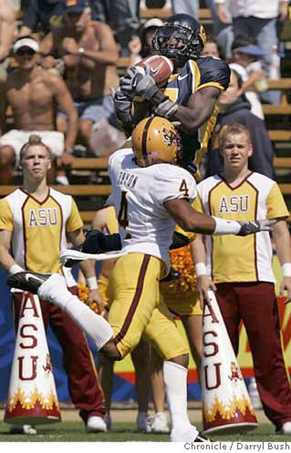 California's Lavelle Hawkins catches a 31 yard touchdown pass from Nate Longshore over ASU's Justin Tryon in the 1st qtr. vs. Arizona State at Memorial Stadium in Berkeley, CA on Saturday, September 23, 2006. 9/23/06  Darryl Bush / The Chronicle ** roster (cq) Photo: Darryl Bush