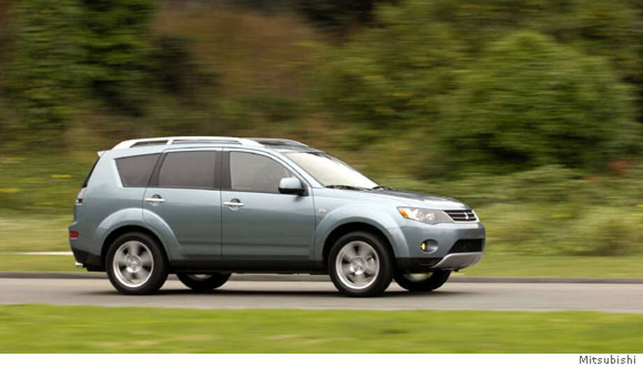 The 2007 Outlander is a compact, car-based, unitized-body crossover utility vehicle. Mitsubishi has jettisoned its bulge-nosed front end in favor of a friendly grille of modest aperture bracketed by smartly angled headlamps. Illustrates WHEELS-OUTLANDER (category l), by Warren Brown � 2006, The Washington Post. Moved Friday, Sept. 8, 2006. (MUST CREDIT: Mitsubishi.)  Ran on: 09-24-2006  The 2007 Outlander, a worthy rival of the top-notch Acura RDX and Mazda CX-7 compact crossover utility vehicles, is a value at $19,000.  Ran on: 09-24-2006 Ran on: 09-24-2006 Ran on: 09-24-2006 Ran on: 09-24-2006 Ran on: 09-24-2006 Photo: HANDOUT
