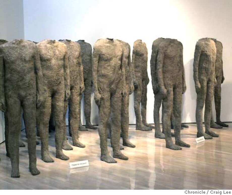"""TASTEROOM320C-C-12MAR03-FD-CL  The Hess Collection tasting room in Napa at 4411 Redwood Road. Photo of an art piece called """"Crowd"""" 1986/8 by Magdalena Abakanowicz, Polish, born 1930. Jason Thomas, an art student at the Art Institute in San Francisco, happened to be passing by looking at the art works.  Photo by Craig Lee/San Francisco Chronicle Photo: CRAIG LEE"""
