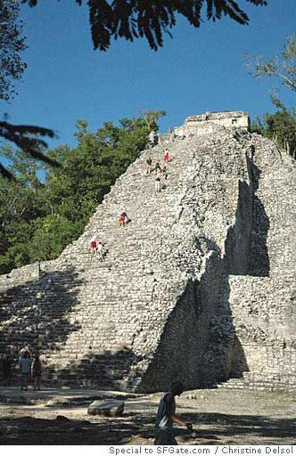 Visitors climb the steps of Cobá, the largest and least-manicured of the Yucatán's Mayan ruins and a great daytrip from Cancún. Photo by Christine Delsol, special to SFGate.com.