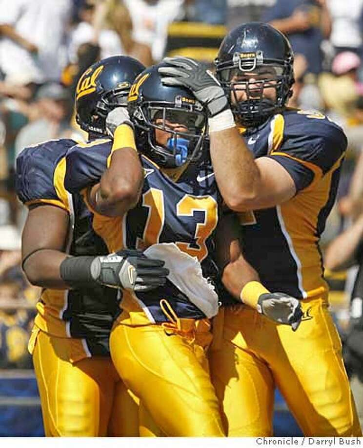 CAL_0008_db.JPG  California's Daymeion Hughes (13) celebrates with teammates following a 2nd qtr. 47 yard interception return for a touch down vs. Arizona State at Memorial Stadium in Berkeley, CA on Saturday, September 23, 2006. 9/23/06  Darryl Bush / The Chronicle ** roster (cq) Photo: Darryl Bush