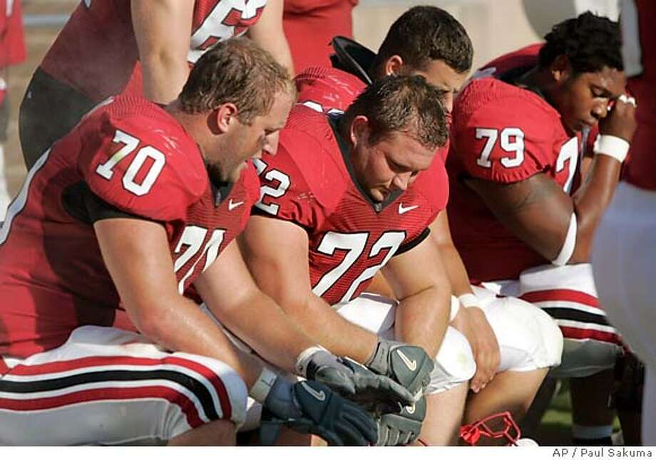 Stanford tackle Jeff Edwards (70), center Mikal Brewer (72) and guard Ismail Simpson (79) sit on the bench late in the fourth quarter of an NCAA football game against Washington State, Saturday, Sept. 23, 2006, in Stanford, Calif. Washington State won 36-10. (AP Photo/Paul Sakuma) EFE OUT Photo: PAUL SAKUMA