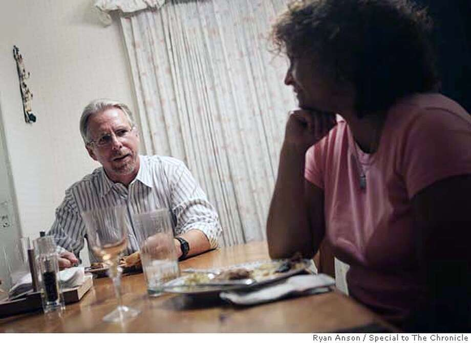 """ISSUES24_002  Anna Nieto (right) and her husband Bruce Frambach share a chicken dinner while talking about baseball at their San Jose home Friday. Frambach, a physician who voted for President George Bush during the last election, says, """"The joke is that I take a stand, and she makes sure the vote goes nowhere."""" Although Nieto agrees that they differ on some political issues, she says they both feel that the state of California needs to reinvest in its education system. Ryan Anson/Special to The Chronicle PHOTO BY RYAN ANSON/ SPECIAL TO THE CHRONICLE Ran on: 09-24-2006  Dr. Bruce Frambach and his wife, Anna Nieto, care about schools. Photo: Ryan Anson"""
