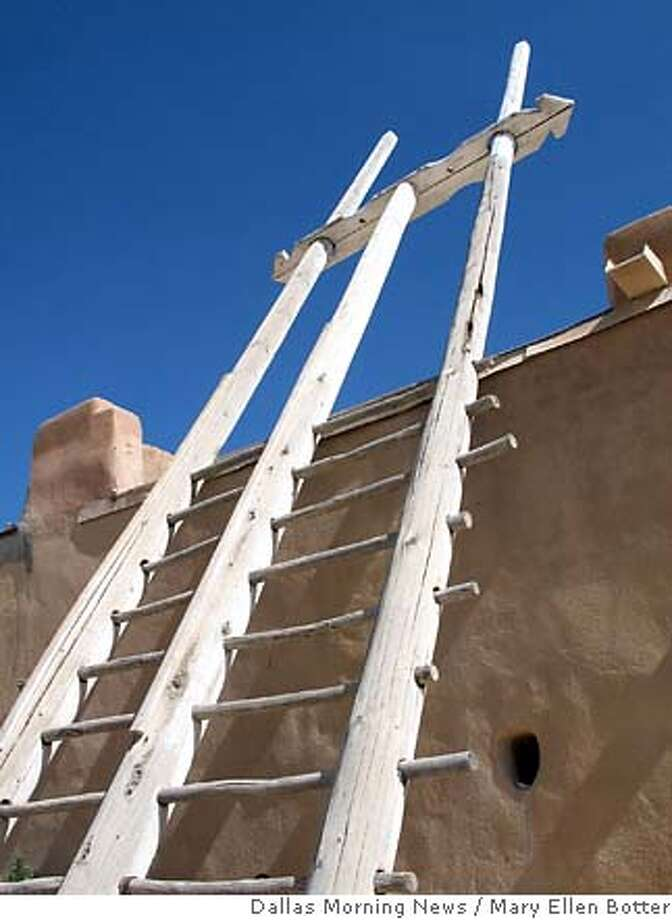 A three-pole ladder leans against the kiva at Acoma Pueblo in New Mexico. (Mary Ellen Botter/Dallas Morning News/MCT) HFA WEB BL NO MAGAZINE SALES Photo: Mary Ellen Botter