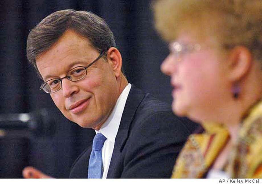 Senator Jim Talent, R-Mo. left, listens to Progressive party candidate Lydia Lewis, right, respond to a question during a Missouri Press Association forum Friday, Sept. 15, 2006, at Lake Ozark, Mo. Talent is being challenged by Democratic state auditor Claire McCaskill in a race which has drawn national attention. (AP Photo/Kelley McCall) Photo: KELLEY MCCALL