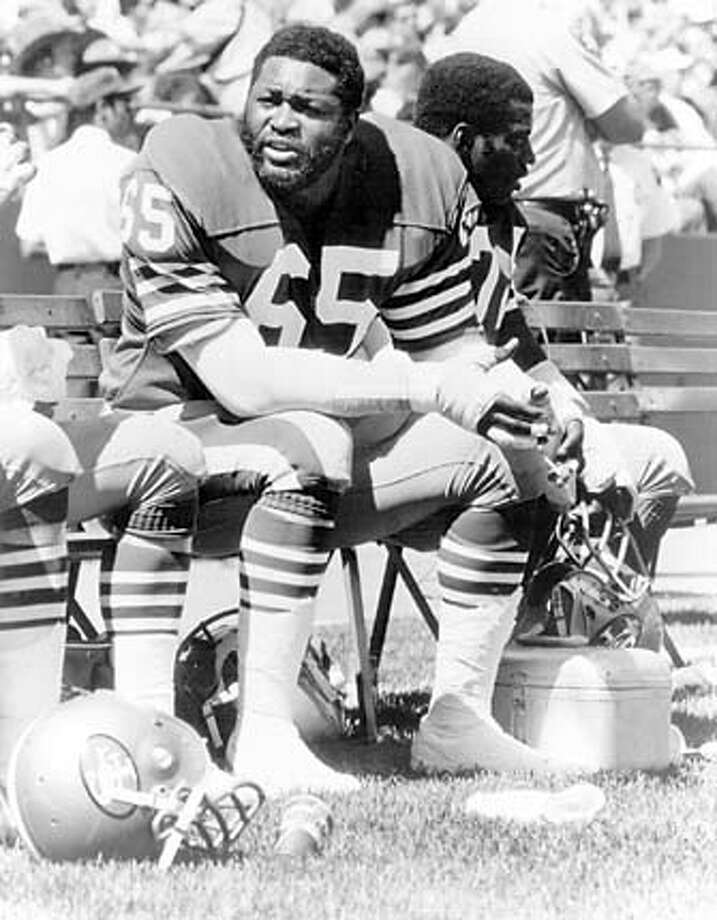 PILLERS24.jpg Lawrence Pillers of the 49ers sits on the bench during a game in 1984. handout/ handout Photo: Handout