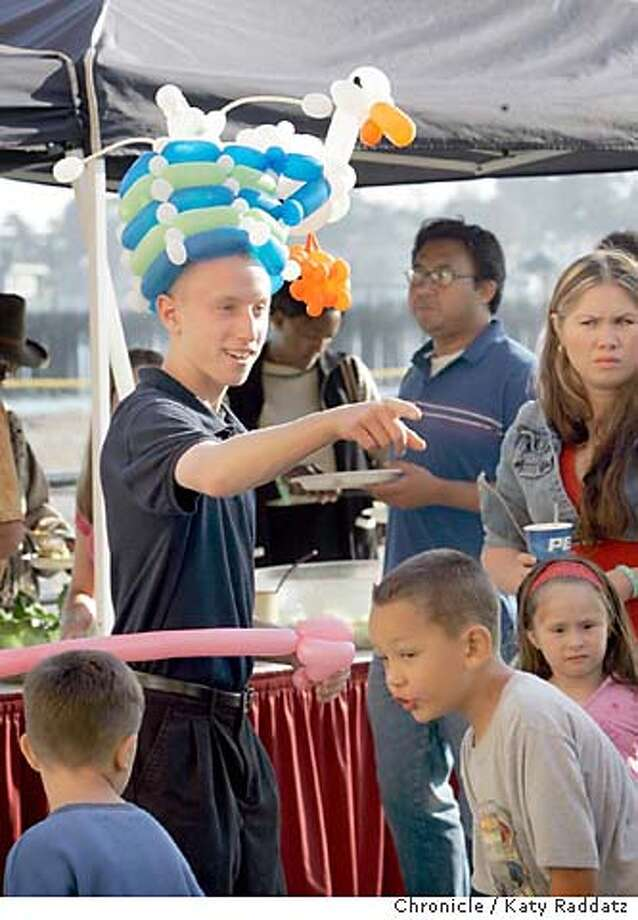 Jonathan Zambole, 16, wears one of his balloon creations as he works the crowd at the Santa Cruz Beach Boardwalk. Chronicle photo by Katy Raddatz
