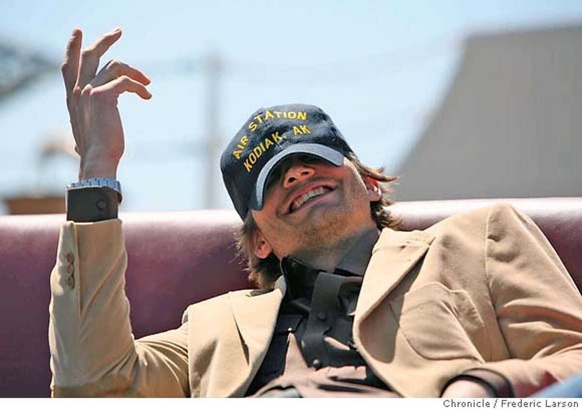 """Actors Ashton Kutcher reacts to a humorous comment of Kevin Costner while visiting Coast Guard Island in Alameda on Monday 8/28 to promote their new film, """"The Guardian."""" The film is about an elite rescue team of Coast Guard swimmers. 8/28/06 {Frederic Larson/The Chronicle } MANDATORY CREDIT FOR PHOTOGRAPHER AND SAN FRANCISCO CHRONICLE/ -MAGS OUT"""