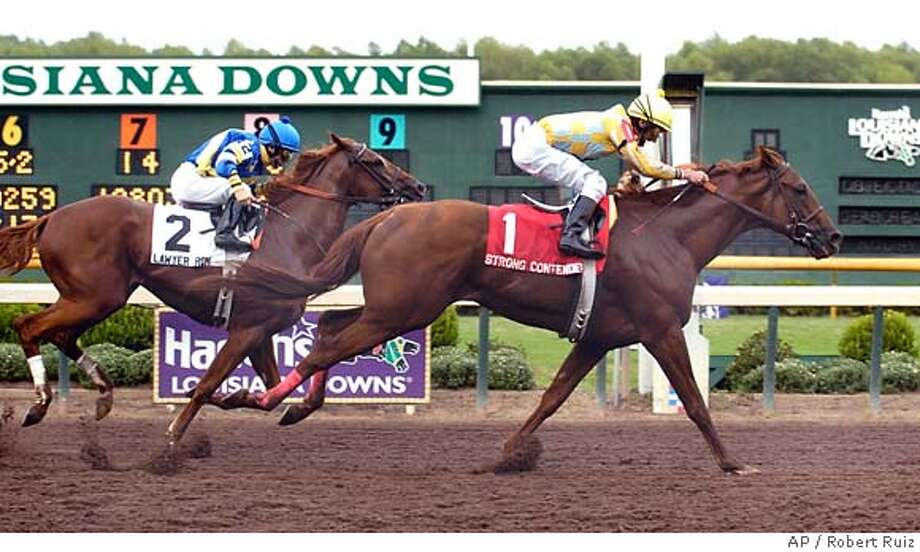 Strong Contender (1), ridden by Robby Albarado, crosses the finish line just before Lawyer Ron (2), ridden by John McKee, to win the $500,000 Super Derby, Saturday, Sept. 23, 2006, at Louisiana Downs in Bossier City, La. (AP Photo/The (Shreveport) Times, Robert Ruiz) ** , MAGS OUT, TV OUT ** , TV OUT, MAGS OUT EFE OUT Photo: ROBERT RUIZ