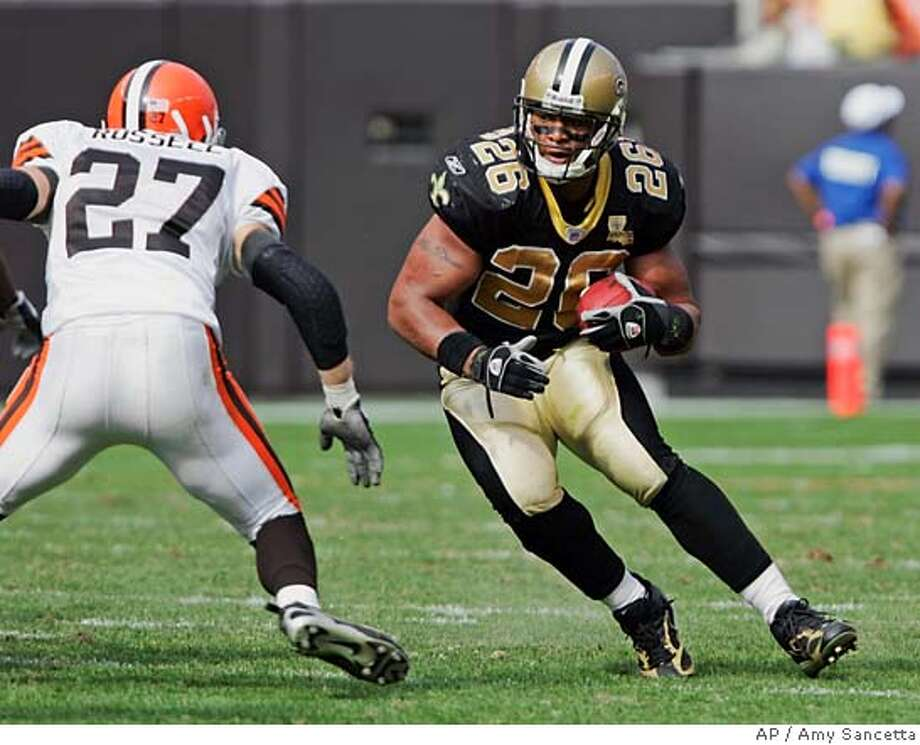New Orleans Saints running back Deuce McAllister (26) attempts to run past Cleveland Browns' Brian Russell in the fourth quarter of an NFL football game Sunday, Sept. 10, 2006, in Cleveland. McAllister gained 90 yards on 22 carries in the Saints' 19-14 win. (AP Photo/Amy Sancetta) EFE OUT Photo: AMY SANCETTA